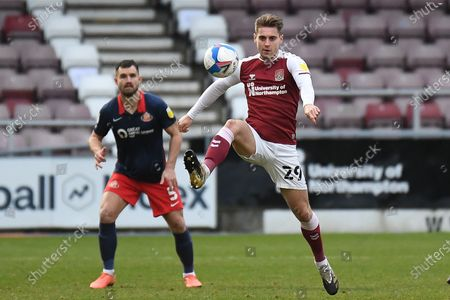 Northampton Town forward Danny Rose (29) controls the ball in the air during the EFL Sky Bet League 1 match between Northampton Town and Sunderland at the PTS Academy Stadium, Northampton