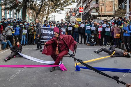 Civil society activists perform street drama on Streets of Maitighar Mandala during the protest.On December 20, the office of President Bidhya Devi Bhandari announced the dissolution of Parliament at the request of Oliís cabinet, while also anticipating general elections now scheduled for April 30 and May 10, more than a year ahead of schedule.