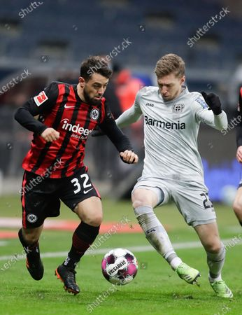 Stock Photo of Leverkusen's Mitchell Weiser, right, and Frankfurt's Amin Younes challenge for the ball during a German Bundesliga soccer match between Eintracht Frankfurt and Bayer Leverkusen in Frankfurt, Germany