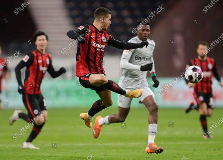 Frankfurt's Andre Silva, center, kicks the ball during a German Bundesliga soccer match between Eintracht Frankfurt and Bayer Leverkusen in Frankfurt, Germany