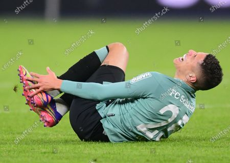 Schalke's Amine Harit on the ground after a foul by Hertha's Lucas Tousart (not in image) during the German Bundesliga soccer match between Hertha BSC Berlin and FC Schalke 04 in Berlin, Germany, 02 January 2021.