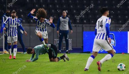 Hertha's Matteo Guendouzi (up) in action against Schalke's Hamza Mendyl during the German Bundesliga soccer match between Hertha BSC Berlin and FC Schalke 04 in Berlin, Germany, 02 January 2021.
