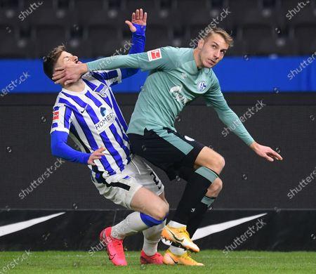 Hertha's Marvin Plattenhardt (L) in action against Schalke's Timo Becker (R)  during the German Bundesliga soccer match between Hertha BSC Berlin and FC Schalke 04 in Berlin, Germany, 02 January 2021.