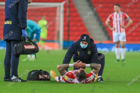 Stoke City forward Steven Fletcher (21) is injured during the EFL Sky Bet Championship match between Stoke City and Bournemouth at the Bet365 Stadium, Stoke-on-Trent