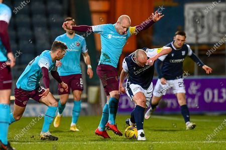 Stock Image of Steven Naismith (#14) of Heart of Midlothian FC looks to tackle Charlie Adam (#26) of Dundee FC during the SPFL Championship match between Dundee and Heart of Midlothian at Dens Park, Dundee
