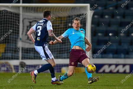 Jordan McGhee (#3) of Dundee FC tackles Christophe Berra (#6) of Heart of Midlothian FC during the SPFL Championship match between Dundee and Heart of Midlothian at Dens Park, Dundee