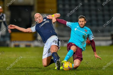 Charlie Adam (#26) of Dundee FC and Peter Haring (#5) of Heart of Midlothian FC contest a ball during the SPFL Championship match between Dundee and Heart of Midlothian at Dens Park, Dundee