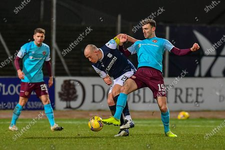 Andy Irving (#19) of Heart of Midlothian FC tackles Charlie Adam (#26) of Dundee FC during the SPFL Championship match between Dundee and Heart of Midlothian at Dens Park, Dundee