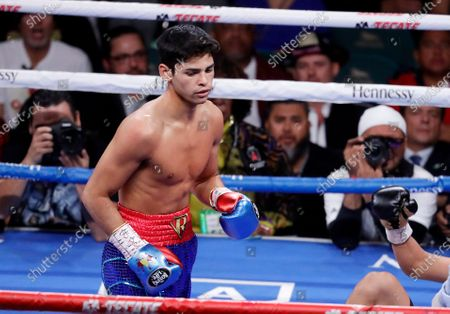 Ryan Garcia, looks on after landing a punch to Romero Duno (not seen) during their lightweight boxing match in Las Vegas. Garcia meets Britain's Luke Campbell, a 2012 Olympic champion, in an interim WBC lightweight title fight. The bout was postponed a month and moved from California after Campbell tested positive for COVID-19