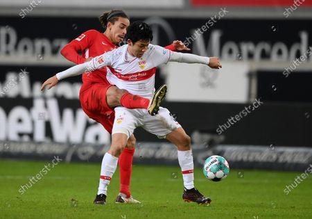 Yussuf Poulsen (L) of RB Leipzig battles for possession with Wataru Endo of VfB Stuttgart during the German Bundesliga match between VfB Stuttgart and RB Leipzig at Mercedes-Benz Arena in Stuttgart, Germany, 02 January 2021.