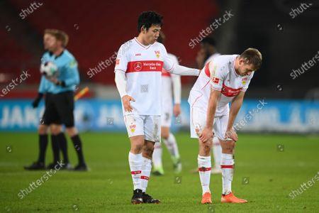 Wataru Endo (L) and Waldemar Anton of VfB Stuttgart reactsafter the German Bundesliga match between VfB Stuttgart and RB Leipzig at Mercedes-Benz Arena in Stuttgart, Germany, 02 January 2021.