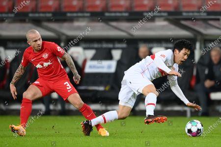 Wataru Endo (R) of VfB Stuttgart and Angelino of RB Leipzig battle for possession during the German Bundesliga match between VfB Stuttgart and RB Leipzig at Mercedes-Benz Arena in Stuttgart, Germany, 02 January 2021.
