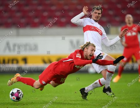 Emil Forsberg (L) of RB Leipzig is fouled by Pascal Stenzel of VfB Stuttgart leading to a penalty decision during the German Bundesliga match between VfB Stuttgart and RB Leipzig at Mercedes-Benz Arena in Stuttgart, Germany, 02 January 2021.