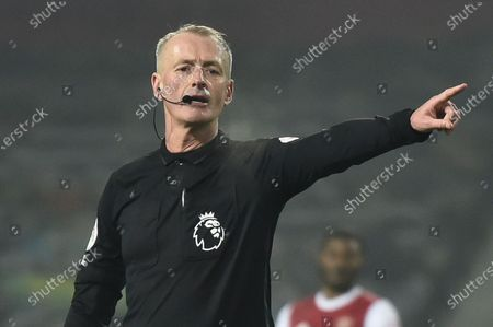 Referee Martin Atkinson reacts during the English Premier League soccer match between West Bromwich Albion and Arsenal London in West Bromwich, Britain, 02 January 2021.