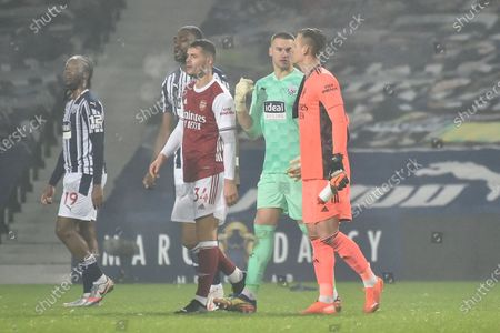 West Bromwich goalkeeper Sam Johnstone (2-R) and Arsenal's Bernd Leno (R) react after the English Premier League soccer match between West Bromwich Albion and Arsenal London in West Bromwich, Britain, 02 January 2021.