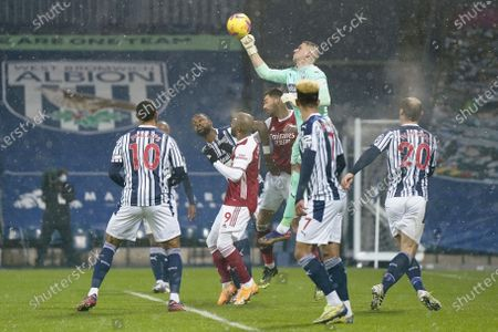 West Bromwich goalkeeper Sam Johnstone (C-up) in action during the English Premier League soccer match between West Bromwich Albion and Arsenal London in West Bromwich, Britain, 02 January 2021.