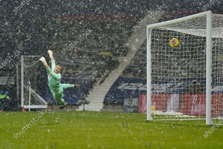 West Bromwich goalkeeper Sam Johnstone concedes the 0-1 goal during the English Premier League soccer match between West Bromwich Albion and Arsenal London in West Bromwich, Britain, 02 January 2021.