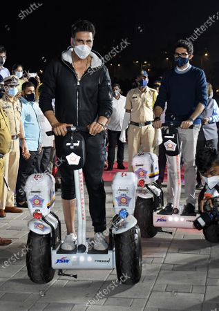 Bollywood actor, Akshay Kumar rides on a Segway during the launch.Segway was launched for the police personnel to patrol the promenade at Worli sea face.