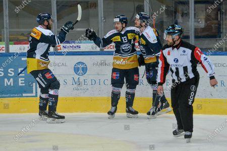 Ambri celebrate the 1:0 goal. From left: #12 Jiri Novotny (Ambri), #13 Marco Mueller (Ambri) and scorer #9 Dario Rohrbach (Ambri)