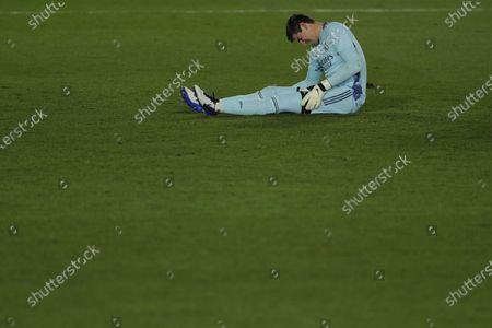 Real Madrid goalkeeper Thibaut Courtois grimaces in pain during the Spanish La Liga soccer match between Real Madrid and Celta Vigo at the Alfredo Di Stefano stadium in Madrid, Spain, . Real Madrid won 2-0