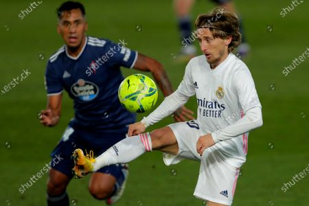 Real Madrid's Luka Modric, right, controls the ball next to Celta Vigo's Renato Tapia during the Spanish La Liga soccer match between Real Madrid and Celta Vigo at the Alfredo Di Stefano stadium in Madrid, Spain, . Real Madrid won 2-0