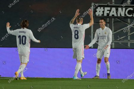Real Madrid's Lucas Vazquez, right, celebrates with teammates Real Madrid's Toni Kroos, center, and Luka Modric after scoring the opening goal during the Spanish La Liga soccer match between Real Madrid and Celta Vigo at the Alfredo Di Stefano stadium in Madrid, Spain