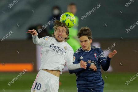 Real Madrid's Luka Modric, left, goes for a header with Celta Vigo's Denis Suarez during the Spanish La Liga soccer match between Real Madrid and Celta Vigo at the Alfredo Di Stefano stadium in Madrid, Spain
