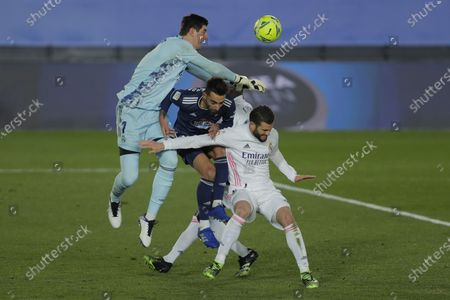 Stock Picture of Celta Vigo's Brais Mendez, center, battles for a ball with Real Madrid goalkeeper Thibaut Courtois, left, and Nacho during the Spanish La Liga soccer match between Real Madrid and Celta Vigo at the Alfredo Di Stefano stadium in Madrid, Spain