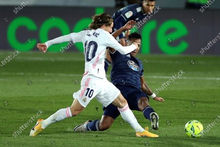 Real Madrid's midfielder Luka Modric (L) vies for the ball against Celta's midfielder Renato Tapia (R) during the Spanish LaLiga soccer match between Real Madrid and Celta de Vigo at Alfredo Di Stefano in Madrid, Spain, 02 January 2021.