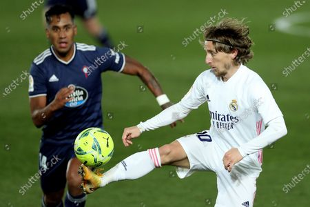 Real Madrid's midfielder Luka Modric (R) vies for the ball against Celta's midfielder Renato Tapia (L) during the Spanish LaLiga soccer match between Real Madrid and Celta de Vigo at Alfredo Di Stefano in Madrid, Spain, 02 January 2021.