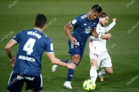 Stock Photo of Tapia of Celta and Luka Modric of Real Madrid in action during the spanish league, La Liga Santander, football match played between Real Madrid and Celta de Vigo at Ciudad Deportiva Real Madrid on january 02, 2021, in Valdebebas, Madrid, Spain