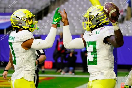 Stock Image of Oregon quarterback Anthony Brown (13) celebrates his touchdown against Iowa State with wide receiver Johnny Johnson III (3) during the first half of the Fiesta Bowl NCAA college football game, in Glendale, Ariz
