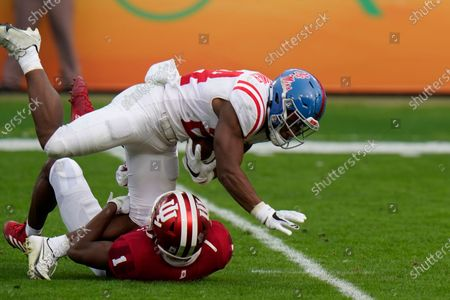 Stock Image of Mississippi running back Snoop Conner is stopped by Indiana defensive back Devon Matthews during the second half of the Outback Bowl NCAA college football game, in Tampa, Fla