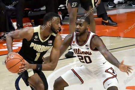 Purdue's forward Aaron Wheeler (1) is pressured by Illinois guard Da'Monte Williams (20) in the second half of an NCAA college basketball game, in Champaign, Ill