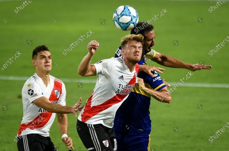 Stock Photo of Lucas Beltran of River Plate and Carlos Izquierdo of Boca Juniors go for a header during Copa Diego Maradona local league soccer match at the Bombonera stadium in Buenos Aires, Argentina