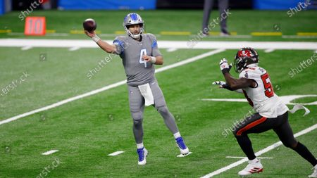 Stock Photo of Detroit Lions quarterback Chase Daniel (4) throws a pass against Tampa Bay Buccaneers outside linebacker Shaquil Barrett during an NFL football game, in Detroit