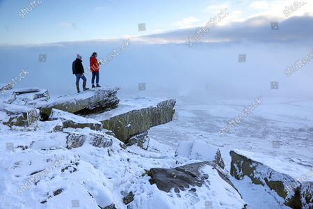 Stock Photo of SNOW and freezing fog will grip parts of the country as Britons welcome the first day of 2021 today, forecasters said last night. Met Office expert Clare Nasir said New Year's Day would see showers in the North falling as snow on higher ground. She added: 'We could actually see some freezing fog lingering on into the afternoon, particularly for the south east of England, and temperatures here will struggle.