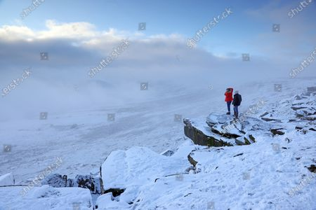 Stock Image of SNOW and freezing fog will grip parts of the country as Britons welcome the first day of 2021 today, forecasters said last night. Met Office expert Clare Nasir said New Year's Day would see showers in the North falling as snow on higher ground. She added: 'We could actually see some freezing fog lingering on into the afternoon, particularly for the south east of England, and temperatures here will struggle.