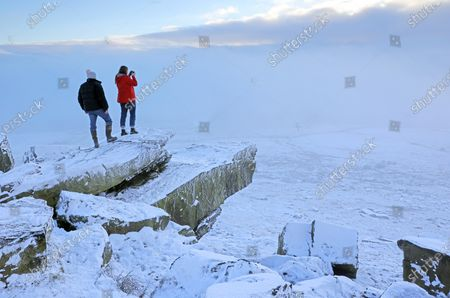 Stock Picture of SNOW and freezing fog will grip parts of the country as Britons welcome the first day of 2021 today, forecasters said last night. Met Office expert Clare Nasir said New Year's Day would see showers in the North falling as snow on higher ground. She added: 'We could actually see some freezing fog lingering on into the afternoon, particularly for the south east of England, and temperatures here will struggle.
