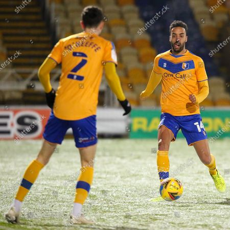James Perch of Mansfield Town passes the ball to Corey O'Keeffe of Mansfield Town