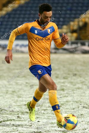 James Perch of Mansfield Town controls the ball