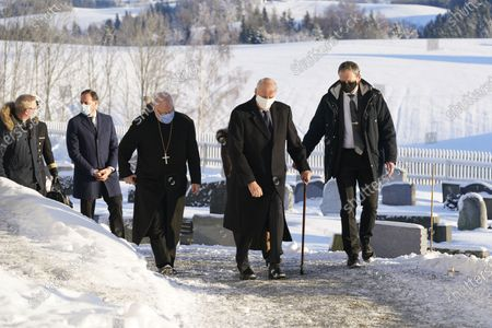 Stock Photo of Norway's King Harald (2-R) and Queen Sonja (unseen) and Crown Prince Haakon (2-L) visit the church in Gjerdrum, Norway, 03 January 2021, in remembrance of the victims of a landslide emergency incident. Several homes have been taken by the landslide in Ask that occurred on 30 December. Several people are missing, and five have been confirmed dead. More than 1,000 people in the area have been evacuated.