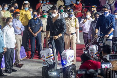 Stock Photo of Environment Minister Aaditya Thackeray, Bollywood actor Akshay Kumar, Maharashtra Home Minister Anil Deshmukh and other leaders during the inauguration of Segway electric scooters for Mumbai police at Worli Seaface, on January 2, 2021 in Mumbai, India. Mumbai Police commissioner Param Bir Singh said that the electric scooters are being provided to the police force for improved policing, visibility and mobility.