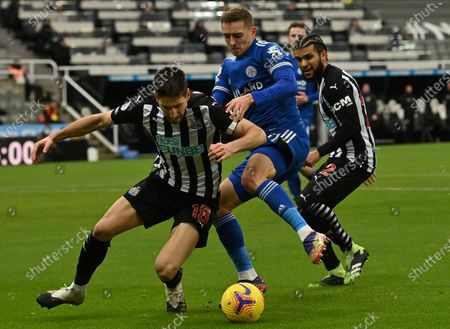 Federico Fernandez (L) and DeAndre Yedlin (R) of Newcastle in action against Timothy Castagne (C) of Leicester during the English Premier League soccer match between Newcastle United and Leicester City in Newcastle, Britain, 03 January 2021.