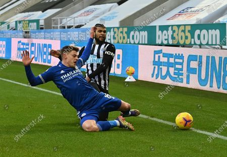Leicester's Harvey Barnes, front, duels for the ball with Newcastle's DeAndre Yedlin during the English Premier League soccer match between Newcastle United and Leicester City at St. James' Park in Newcastle, England