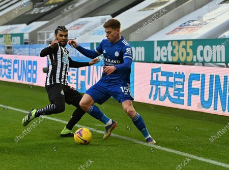 Leicester's Harvey Barnes, right, duels for the ball with Newcastle's DeAndre Yedlin during the English Premier League soccer match between Newcastle United and Leicester City at St. James' Park in Newcastle, England