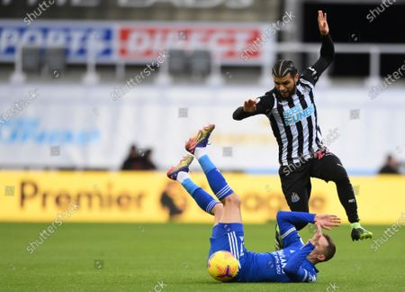Newcastle's DeAndre Yedlin, top, duels for the ball with Leicester's Timothy Castagne during the English Premier League soccer match between Newcastle United and Leicester City at St. James' Park in Newcastle, England