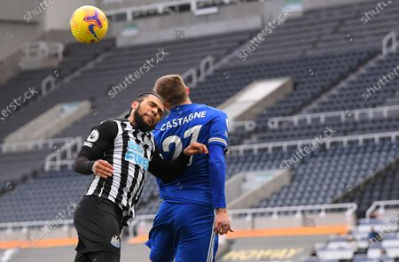 Newcastle's DeAndre Yedlin, left, jumps for the ball with Leicester's Timothy Castagne during the English Premier League soccer match between Newcastle United and Leicester City at St. James' Park in Newcastle, England