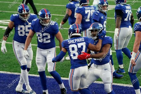 New York Giants' Sterling Shepard (87), center, celebrates his touchdown during the first half of an NFL football game against the Dallas Cowboys, in East Rutherford, N.J