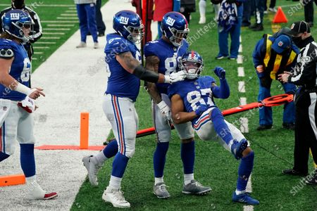 New York Giants' Sterling Shepard (87), right, celebrates his touchdown during the first half of an NFL football game against the Dallas Cowboys, in East Rutherford, N.J